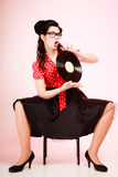 Retro music. Pinup girl with vinyl record Royalty Free Stock Photos