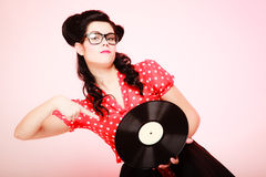 Retro music. Pinup girl with vinyl record Stock Image