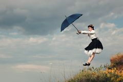 Retro Woman with Umbrella Up in The Air in Fantasy Portrait royalty free stock image