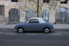Retro car on empty Valletta street royalty free stock images