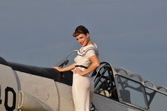 Retro navy girl with a vintage aircraft Royalty Free Stock Photo