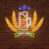 Retro neon Beer Bar sign on brick wall background. Stock Photo