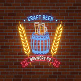 Retro neon Beer Bar sign on brick wall background. Stock Photos