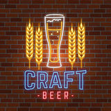 Retro neon Beer Bar sign on brick wall background. Royalty Free Stock Photo