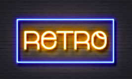 Retro neon sign on brick wall background. Royalty Free Stock Image