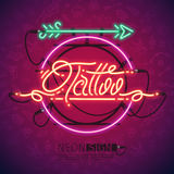 Retro Neon Tattoo Sign with Arrow Stock Photos