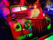 Retro neonlastbil Arkivbild