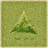 Retro New Year's card with a green Christmas tree Royalty Free Stock Photo