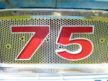 Retro Number seventy five. A distinct number 75. Could be used in a variety of artistic ways as background or incorperated into designs and artworks Stock Images