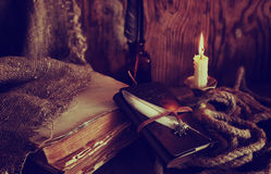 Retro objects feather and leaher book with candle light Stock Photo