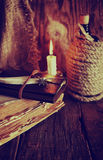 Retro objects feather and leaher book with candle light Royalty Free Stock Photo