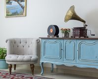 Retro off white armchair and vintage wooden light blue sideboard Royalty Free Stock Photo