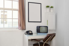 Retro Office Desk. A Retro Style Office Space With Empty Frame Stock Image