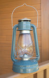 Retro oil kerosene lantern over country house part Royalty Free Stock Image