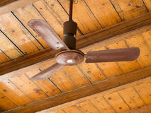 Retro, old brown ceiling fan on wooden ceiling detail. Stock Photo