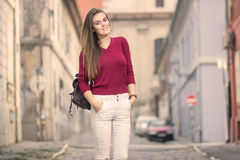 Retro old city street out of focus young girl posing outdoors su Royalty Free Stock Image