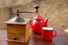 Retro old coffee grinder with vintage red teapot Royalty Free Stock Photography