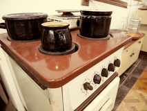 Retro old cooking stove with pots. Stock Photo
