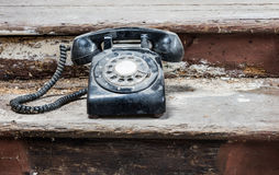 Retro old dusty telephone Stock Photography