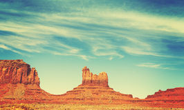 Retro old film style rock formations in Monument Valley, USA. Royalty Free Stock Image