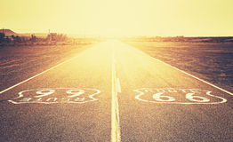 Retro old film style sunset over Route 66. Royalty Free Stock Photos