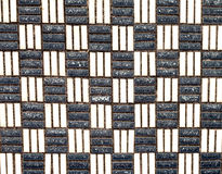 Retro Old Grid of Dark Grey and Cream Tiles Royalty Free Stock Image