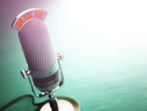 Retro old microphone with text on the air. Radio show or audio p Royalty Free Stock Photos