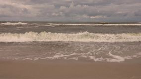 Waves approaching the beach stock video footage