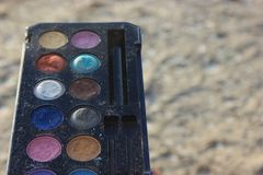 Retro old vintage photo of pallette make up , 60s 70s fashion, blue, white, bright macro close up background neutral. Vintage colorful eye shadow from 70s, 60s stock photography