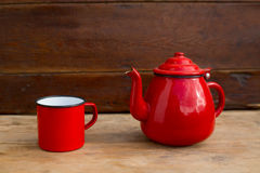 Retro old vintage teapot and red cup Royalty Free Stock Photos