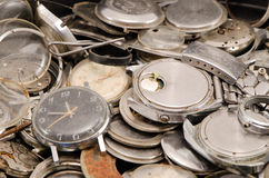 Retro old watches clocks parts pile heap closeup. Retro old watches clocks and parts pile heap closeup Royalty Free Stock Photography