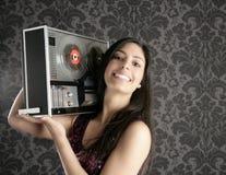 Retro open reel tape recorder brunette Dj Royalty Free Stock Image