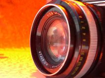 Retro Orange Camera Lens Stock Photo