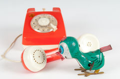 Retro orange telephone with rotary dial on white Stock Images
