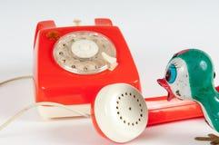 Retro orange telephone with rotary dial on white Royalty Free Stock Photo