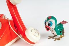 Retro orange telephone with rotary dial on white Stock Photo