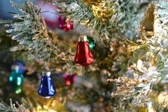 Retro ornaments on christmas tree. Retro ornaments on a christmas tree with frosted snow Stock Image