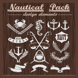 Retro pack of nautical elements, logos and badges on a wooden background. Retro pack of nautical elements, logos and badges on a wooden dark background Royalty Free Stock Photo