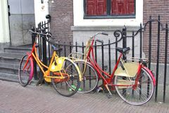 Retro painted students bikes along canal houses, Leiden, Netherlands Stock Photo