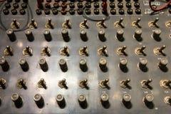 Retro pannello di controllo con gli scambisti ed i bottoni Fotografia Stock Libera da Diritti