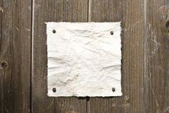Retro Paper On Wooden Wall Royalty Free Stock Image