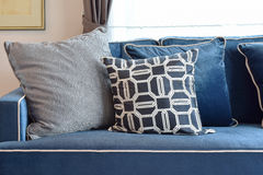 Retro pattern, gray and blue pillow setting up on sofa Stock Photos