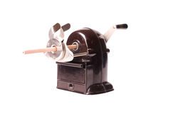 Retro pencil-sharpener with pencil Royalty Free Stock Photography