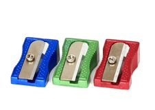 Retro pencil sharpeners. Red, green, and blue pencils sharpeners isolated against a white background Stock Photo