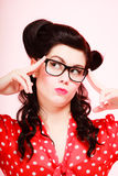 Retro. Pensive thoughtful pinup girl in eyeglasses Stock Photography