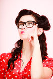 Retro. Pensive thoughtful pinup girl in eyeglasses Royalty Free Stock Images