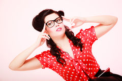 Retro. Pensive thoughtful pinup girl in eyeglasses. Retro. Pensive stylish woman student or teacher in eyeglasses on pink. Thoughtful girl in pinup style stock photo