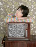 Retro pensive woman on vintage wooden tv 60s Royalty Free Stock Image