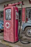 Retro Petrol Pump and Cars royalty free stock photos
