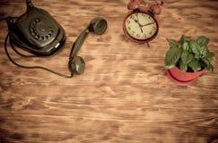 Retro phone and alarm clock Stock Photography